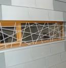 Grille de défense en acier stylisée pour sécurisation de fenêtres